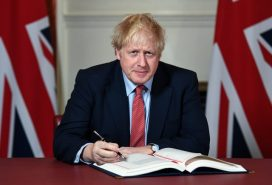 Prime Minister Boris Johnson signs the Withdrawal Bill.